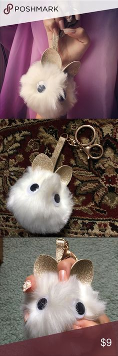 Cute Kitty Pom Pom keychain Brand new  As you girls probably noticed these adorable fluffy keychains have become the latest fashion trend. This one is a rare cute little kitty with glitter gold ears   Cute rare kitty Pom Pom keychain perfect to hold keys, clip onto purses, etc.   Add a little cute anywhere! Plus it's so soft!!! Accessories Key & Card Holders
