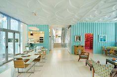 Owned by toy accessory designer, Debbie Glassberg, this airy 2600-square foot pad is filled with turquoise walls and exhibitionist-friendly floor-to-ceiling windows and, it is constructed entirely out of five shipping containers.