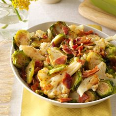 Roasted Cauliflower & Brussels Sprouts with Bacon Recipe -This is a deeply delicious and sure-fire way to get my husband to enjoy Brussels sprouts. Between the roasted flavor of the veggies and smoky, crisp bacon, it will convert even the pickiest eater. —Lisa Speer, Palm Beach, Florida