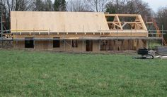 Eco house - timber frame and SIPs panels by Castle Ring Oak Frame