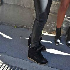 I'm digging the black hi tops with leather pants but I'm seriously digging those little pointy black booties in the background..., want now!!