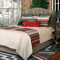 The Southwest Luray Bedding Collection combines the serenity of cool grays and creams with the boldness of fiery red and black for a southwestern spin on home decor. A handsome gray coverlet is adorned with a bright bed runner featuring geometric patterns on one side and plaid on the reverse.