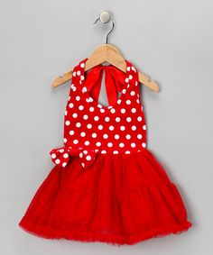 This frock's tiered, drop-waist skirt and ribbon halter straps prove a totally charming combination. Dainty ruffles grace the bottom hem for an extra ounce of cute.65% polyester / 35% cottonDry cleanImported