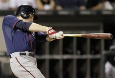 Minnesota Twins' Justin Morneau hits a two-run home run against the Chicago White Sox during the ninth inning of a baseball game in Chicago, Thursday, May 24, 2012
