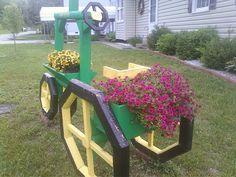 Landscape timber tractor with flowers