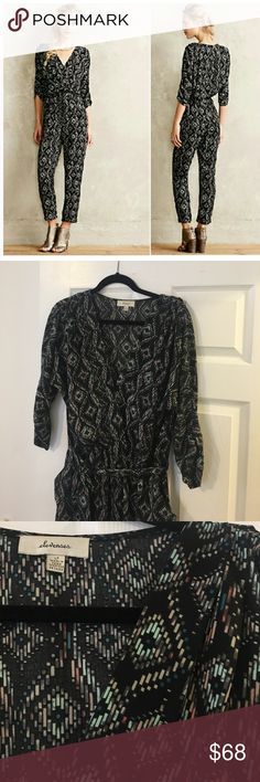 Geo Romper This Romper is super comfy. Black background with orange an blue geometric motif. Can be dressed up or dressed down! Like new! Worn only a few times Anthropologie Pants Jumpsuits & Rompers