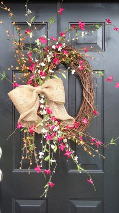Summer airy wreath with burlap bow, would look nice with fall colors, too.