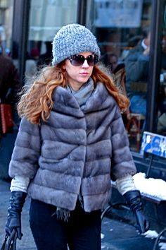 Sheered mink jacket in steely gray, paired with long black leather gloves, blue jeans and a dome shaped steely blue-gray knit hat in SoHo.