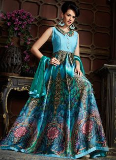 This blue satin designer gown is adding the beautiful glamorous displaying the sense of cute and graceful. You could see some intriguing patterns carried out with digital print and embroidered work.