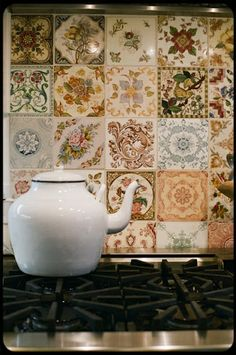Salvaged Tile samples and one of a kind tiles create a unique backsplash wall for kitchen or bath.  Recycle, upcycle, repurpose!  For ideas and goods shop at Estate ReSale & ReDesign, Bonita Springs, FL