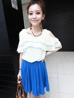 Blue pleated midi skirt dress with elastic waist and contrasting ruffle top with cut out shoulders.