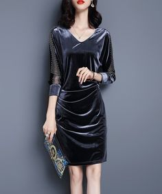 An allover velvet finish and a flattering silhouette lends trend-right sophistication to your closet with this dress.