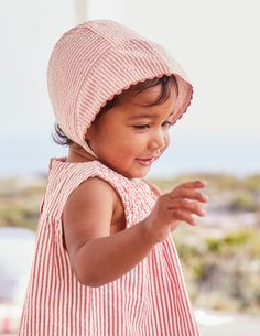 There's nothing like a traditional baby bonnet to get us oohing and aahing. But it's not just a pretty shape, it's also practical – it sticks out far enough to keep your little one's face shaded from bright sunlight and the fastening under the chin keeps it secure.