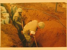Pfcs Smith and Jackson of Bravo Company, 1st Battalion, 26th Marines digging a…