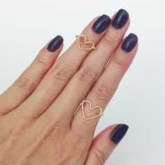 Make these stylish dainty DIY wire heart rings with with this easy tutorial. Complete with step-by-step instructions and pictures.