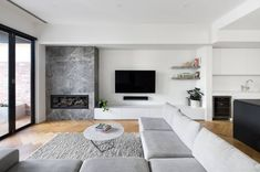 A refined material palette comprised of timber and a Portsea marble fire place. Living Room Decor Fireplace, Fireplace Tv Wall, Modern Fireplace, Living Room Tv, Fireplace Design, Living Room Kitchen, Interior Design Living Room, Living Room Designs, Living Room Tables