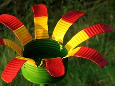 Painted Recycled Metal Flower - candle holder / plant trainer, for the garden. $16.00, via Etsy.