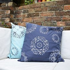 No expensive stencil needed for this DIY pillow transformation with a paper doily and paint.