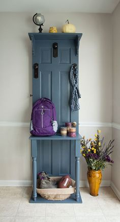 Here's how to turn an old door into an attractive and very useful hall tree. This is a terrific storage solution for coats, boots, hats and more in the entryway or mudroom. It's made from an old panel door with door and cabinet hardware as hooks.: