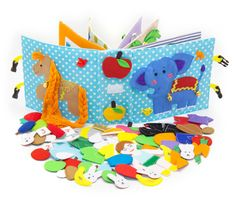 Quiet active book made of cloth is recommended for children from 1 year old. It consists of 7 sheets. The window on the cover we can specify the name of your child.  On every of 12 pages there are different kinds of clasps:  -Velcro  -Buttons  -Knobs  -Shoelaces  -Zipper  -Pins  -Yarn  The hardcover of the quiet active book also contains developing elements on Velcro, mini maze with a ladybird, buttons and ribbons. You can enter any title of the book.  Textile developing book is fastened by…