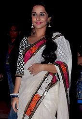 The traditional patterns used on this saree maintain the ethnic look. This bollywood style white saree is nicely designed with embroidered and patch border work is done with resham, zari and sequins work. Saree gives you a singular and dissimilar look. Contrasting black blouse is available. Slight color variations are possible due to differing screen and photograph resolution.