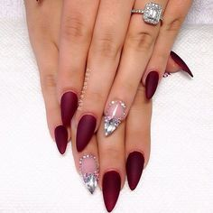 Great looking maroon nail art design for just about any skin tone. The dark hue of the maroon makes the nail design stand out even more with the help of silver embellishments on top.