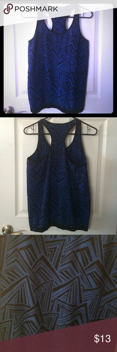 Fabletics royal blue and black geometric tank Worn once. Unfortunately I hate long tags as fabletics tends to have so as shown in the picture the brand tag and size has been cut off. (They are so itchy) I usually order size large in their tops. Otherwise in excellent condition. Fabletics Tops Tank Tops