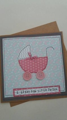 Want to welcome a new baby? Look no further than this cute baby pram design card. This handcrafted card would make a lovely new baby card, baby shower card,baby annoucement card,new parents card. Made with layered paper detail and outlined in ink with ribbon and button detail.