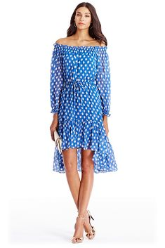 The epitome of effortless, the DVF Camila Two brings bohemian glamour from day to night in a polka dot print. Can be worn on or off shoulders. Elastic at neck and wrists. Ties at waist. Pull on style. High-low skirt. Falls to above the knee in front. Fit is true to size.