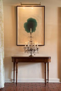 modern painting - antique console. from lonny