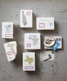 Postcards, matchbooks, and coins tell the stories of our travels, but back home these trinkets tend to get lost in a junk drawer. Instead, give vacation souvenirs—as well as snapshots—a more fitting home with this project adapted from Paper + Craft ($19.95; Chronicle).  Step 1: To source the geographical shape of your travel destination, type its name (Hawaii, Africa, Manhattan, etc.) and the word silhouette into Google. Print out a resulting image and use a copier to resize it to fit on…