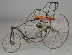Child's Iron Pedal Tricycle, The Gendron Iron Wheel Company, Toledo, Ohio, late 19th century, with manufacturer's tag on the back of the seat, ht. 23 1/4, wd. 18 1/2, lg. 35 in.