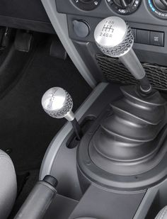 Transform the look and feel of the interior with a Drake transfer case shifter knob. This custom shift knob is CNC machined from solid 6061-T6 billet aluminum with brushed surfaces and a clear anodized finish. The soft tire tread insert adds comfort, uniqueness and extra grip.