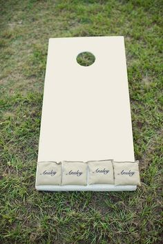 Customize a cornhole game for your wedding reception by putting the bride's name on one set of bags, and the groom's name on the other. (We're betting on Team Bride!)