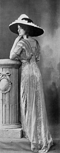 An elaborate dinner gown of 1910. Broad-brimmed hats of this kind were sometimes…