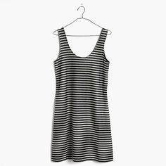 "Understated and effortlessly cool, this striped tank dress comes in a lightly textured knit that's perfect for layering (just how we like it).  <ul><li>Nonwaisted.</li><li>Falls 34 5/8"" from highest point of bodice.</li><li>Cotton/poly.</li><li>Machine wash.</li><li>Import.</li></ul>"