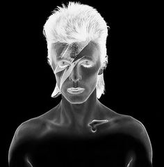 """Motor sensational...  "" Aladdin Sane negative by Brian Duffy. Duffy worked on five important photo shoots with Bowie, including the cover for the Aladdin Sane (1973) album, whose iconic image of Bowie with a lightening bolt painted across his face, is often called ""The Mona Lisa of Pop Culture."""