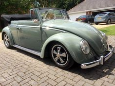 Mark Stockton, Durley, Hampshire, United Kingdom. With his Volkswagens in the garage. 1959 original RHD VW Convertible Beetle. 1641 engine, pro street gearbox, narrowed beam, drilled Porsche pattern disc brakes up front, Porsche pattern drums on rear. 1959 lowlight Cabrio Ghia, 2276 engine, 48idf carbs, web 86b cam...