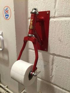I would redesign this to be more practical. I don't like the bike fork so much as the idea that the toilet paper is never the wrong way. - i don't like I would redesign this to be more practical. I don't like the bike fork so much as the idea that the toi