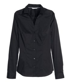 Fitted, long-sleeved shirt in stretch fabric with V-neck. Buttons at front and at cuffs.