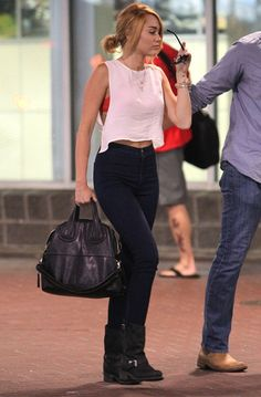 Miley Cyrus | June 2012  White Crop Top (similar)  Red Bralette (similar) American Apparel Easy Jeans Frye Engineer 12R Boot Givenchy Nighti...