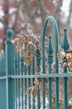 turquoise | wrought iron fence