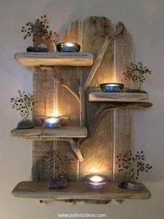 Now this is something beyond my comprehension, this is so elegant and adorable that I am literally running short of words to describe this wooden pallet beauty. We have used some driftwood pieces as well in making this wooden pallet wall shelf which carries all the decorative stuff.