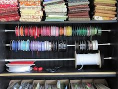 put curtain rod inside classroom cabinet to hold fishing line, sticker rolls, wire, ribbon, etc.