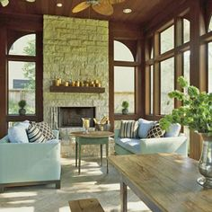 Stone fireplace in contrast to rich wood paneling