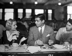 "The original caption reads: ""Carole Lombard and Clark Gable, featured in Paramount's No Man of Her Own, aren't proud. They usually sit at the lunch counter with the rest of the hard-working studio employees."""