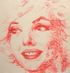 painting by kissing the canvas with lipstick on