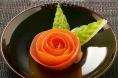Tomato rose and carved cucumber leaves
