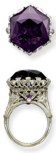 A BELLE EPOQUE AMETHYST AND DIAMOND RING Set with an hexagonal amethyst to the openwork millegrain diamond-set gallery and half-hoop, circa 1915