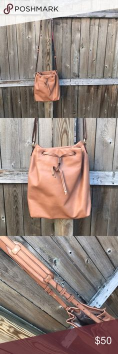 Banana Republic Leather Bucket Bag - Camel Banana Republic Leather Bucket Bag - Camel, inside zip + open pockets, Tie closure -great for spring Banana Republic Bags Crossbody Bags